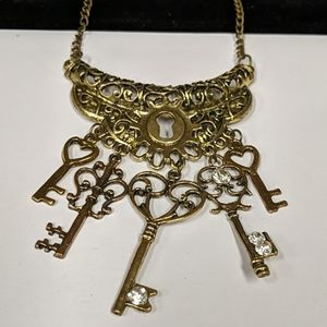 Long lock and key statement necklace